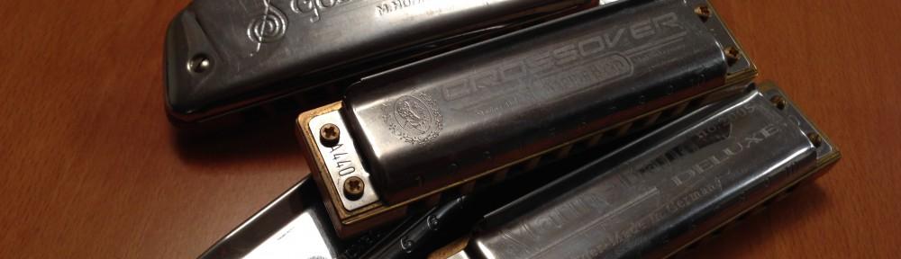 A pile of harmonicas